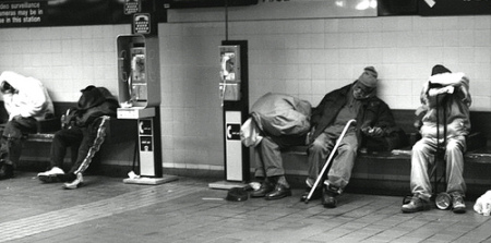 photo of men sleeping on subway platform