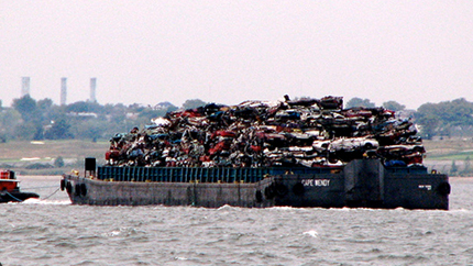 garbage barge sailing past the Statue of Liberty