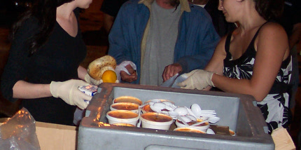 photo of volunteers distributing soup