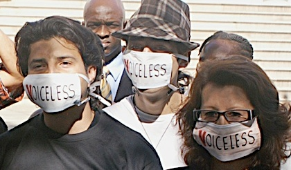 Photo of protesters wearing 'Voiceless' masks.