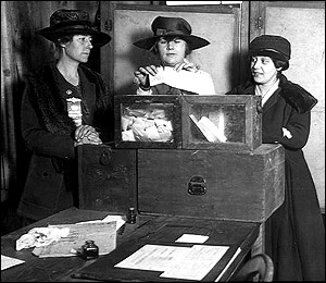 Three suffragists casting votes in New York City, 1917.