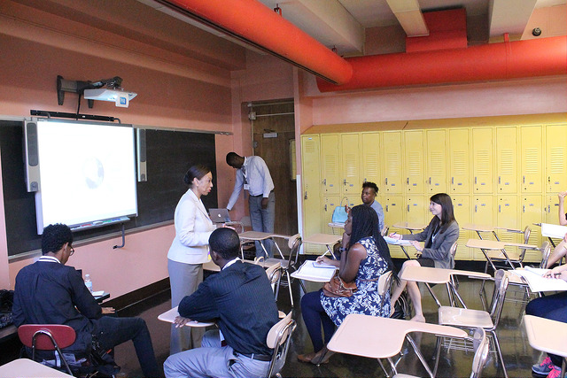 classroom teacher board students desks