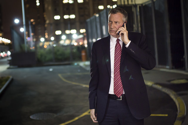 de blasio on phone we don't know with who