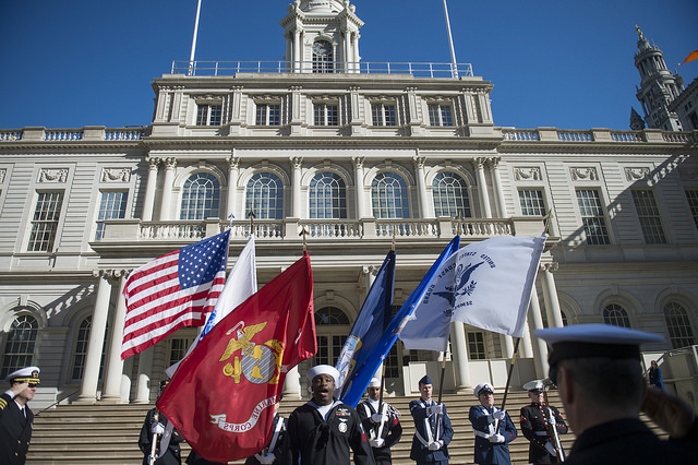 veterans outside city hall flags