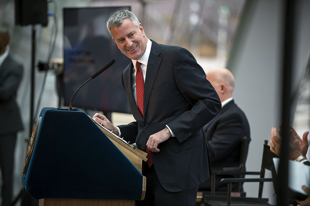 de Blasio press conference smile