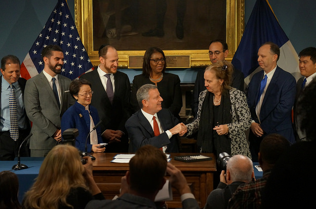 brewer de blasio bill signing