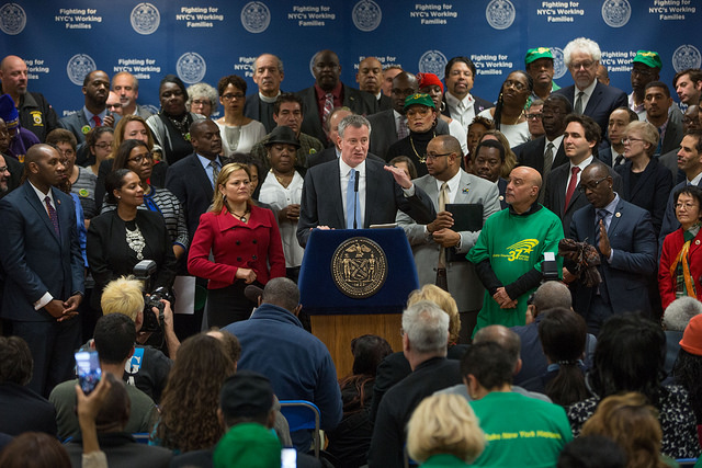 de blasio minimum wage announcement crowd