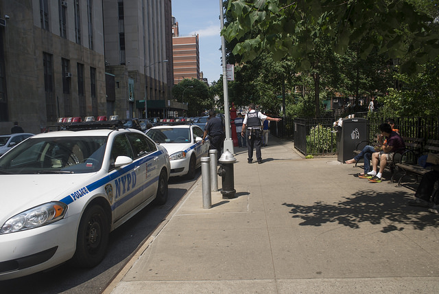 NYPD sidewalk park cars