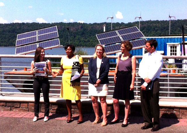 The author, far left, & others at a solar panel event