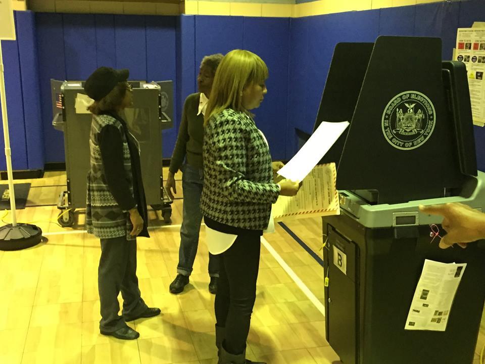 Pam Harris voting via Facebook