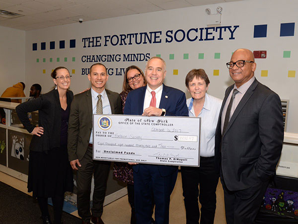 comptroller dinapoli with check nyscomptroller