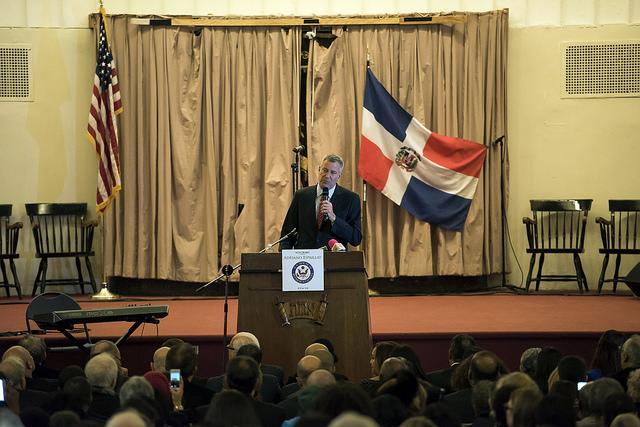 De Blasio speaking podium uptown