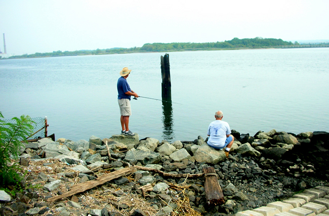 Fishermen off of Arthur Kill public boat launch in Carteret